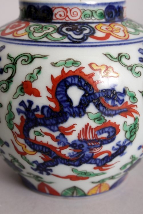 A CHINESE WUCAI PORCELAIN DRAGON JAR & COVER, the base - 9