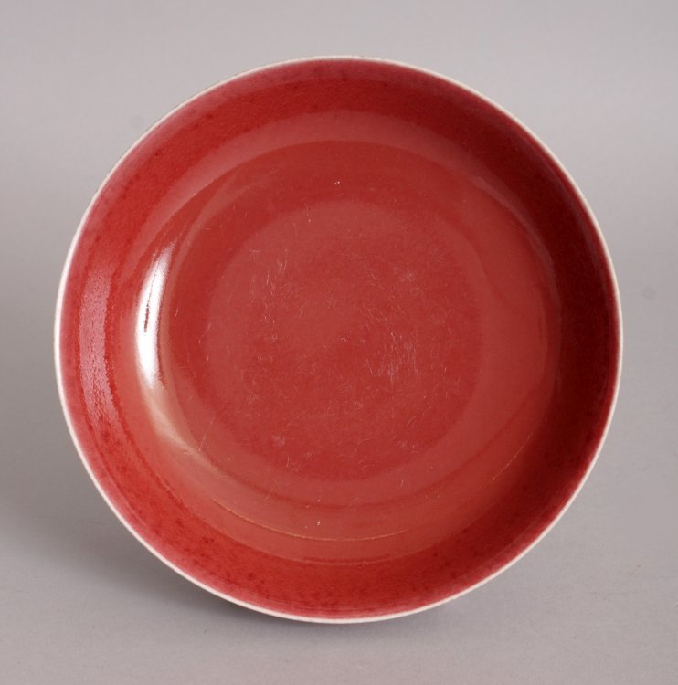 A CHINESE COPPER RED PORCELAIN SAUCER DISH, the base