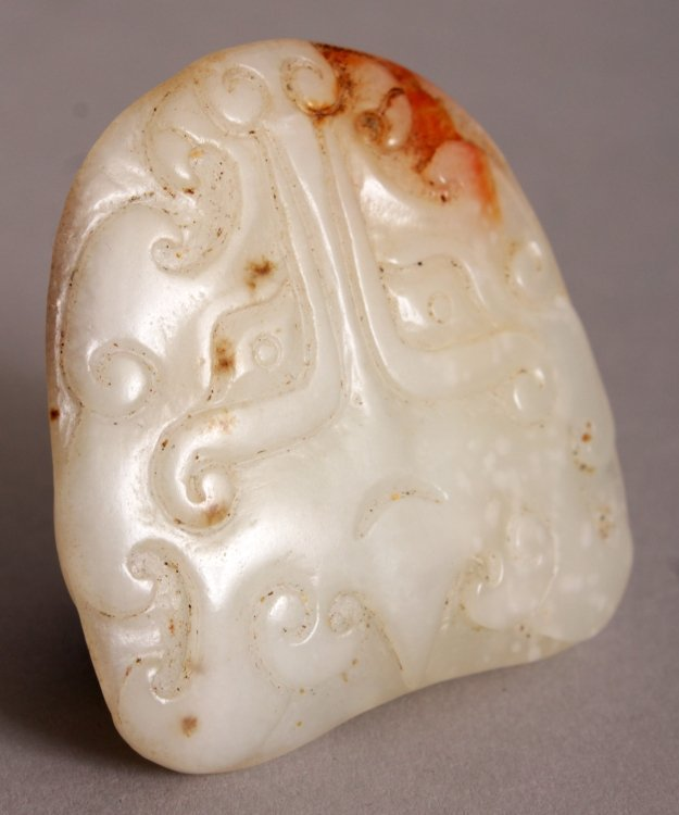 A CHINESE WHITE JADE CARVING, each side with an archaic - 4