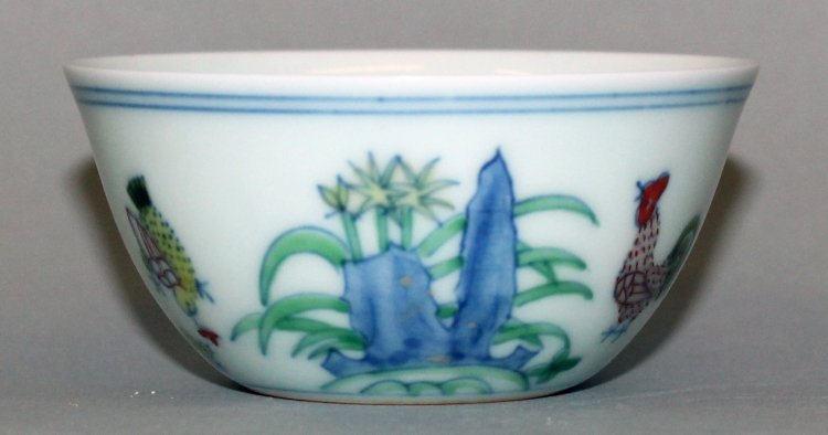 A CHINESE DOUCAI PORCELAIN CHICKEN CUP, the base with a