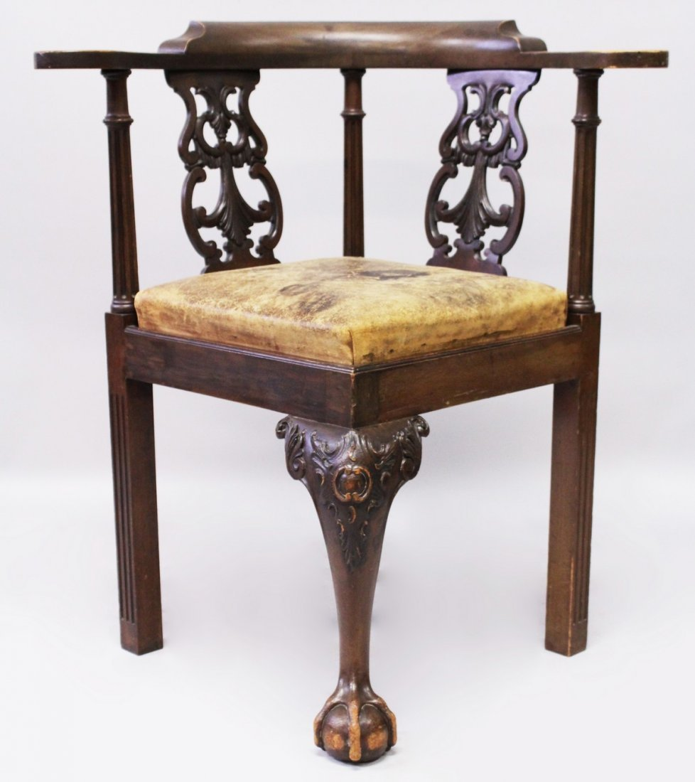 A GEORGE III STYLE MAHOGANY ARMCHAIR, with carved and