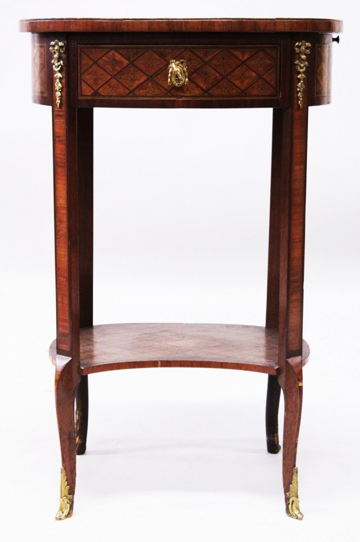 A SMALL 19TH CENTURY LOUIS XVI DESIGN OVAL PARQUETRY
