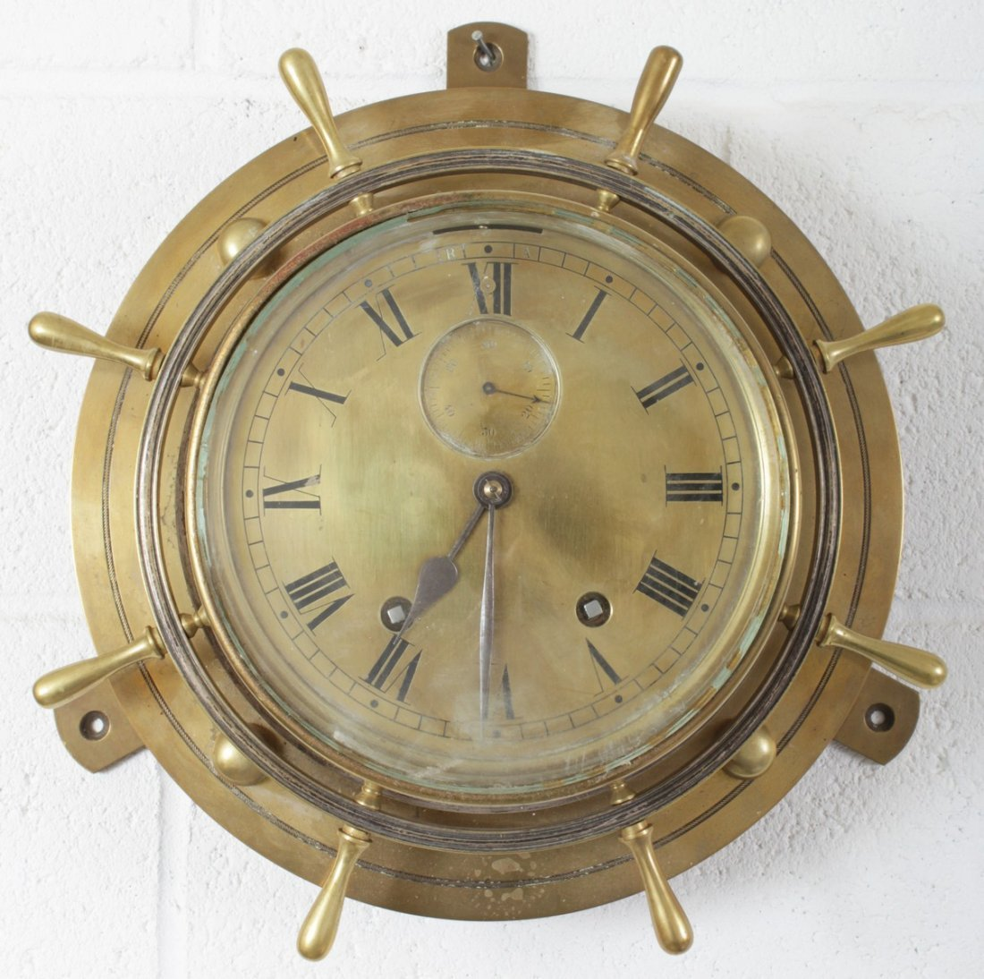 A GOOD LARGE BRASS SHIPS CLOCK striking on two bells.