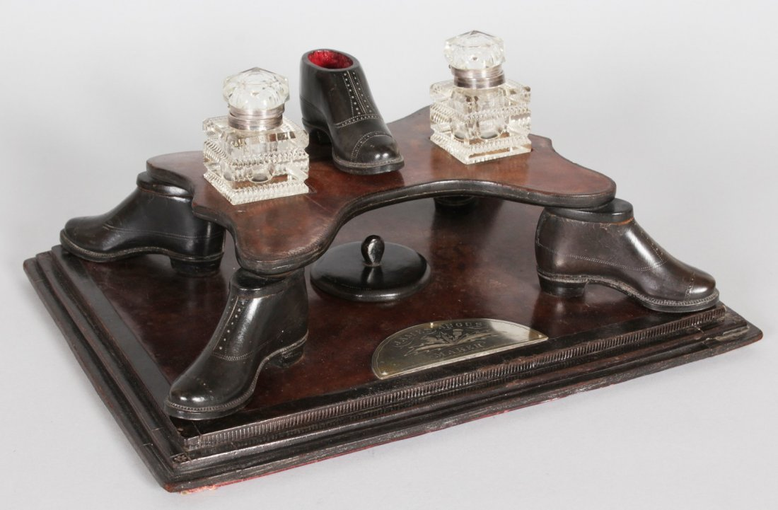 A VERY RARE UNUSUAL LEATHER DESK INKWELL, made by JAMES