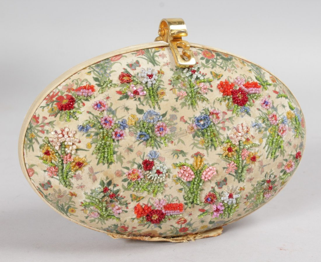 AN OVAL PURSE with bead work.