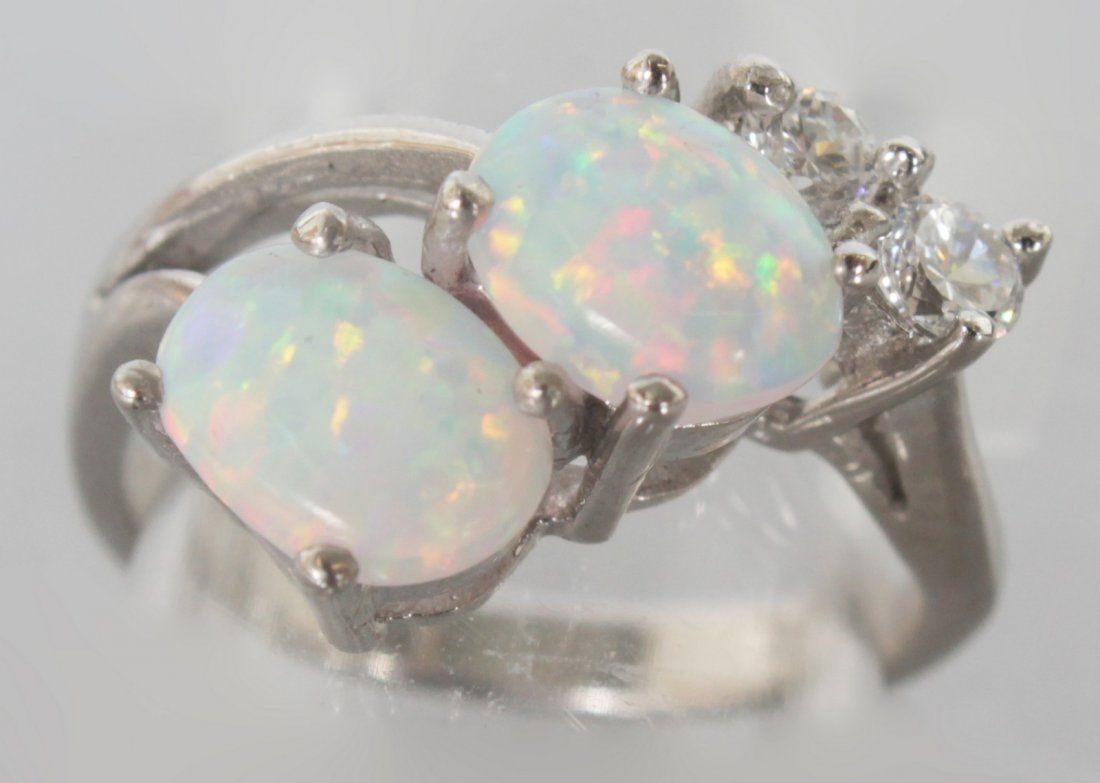 A GILSON OPAL AND BRILLIANT DRESS RING.