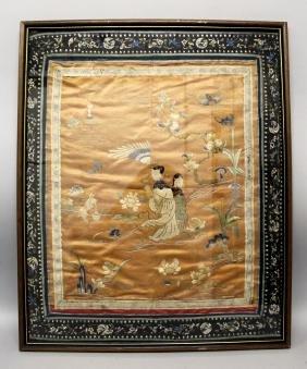 A 19TH CENTURY FRAMED CHINESE ORANGE GROUND SILK