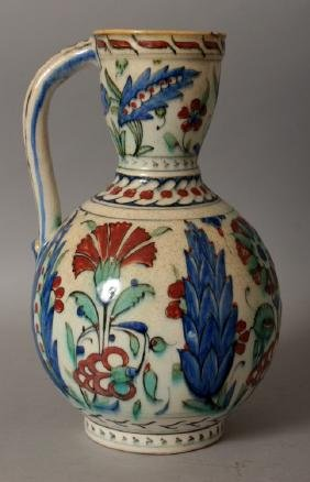 A 19TH/20TH CENTURY ISLAMIC ISNIK EWER, painted with