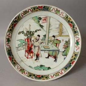 A CHINESE KANGXI PERIOD FAMILLE VERTE PORCELAIN SAUCER