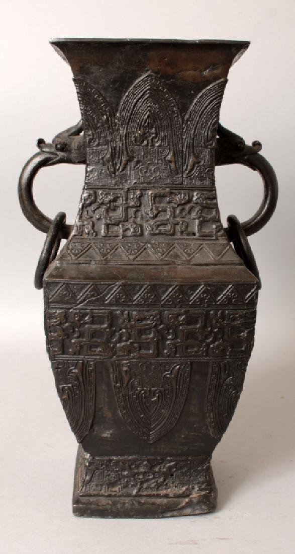 A CHINESE SQUARE SECTION BRONZE VASE, the sides cast