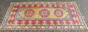 A TURKISH LONG CARPET, beige ground with three large