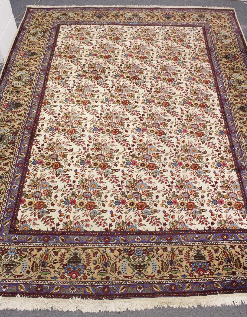 A PERSIAN DESIGN CARPET, cream ground with floral
