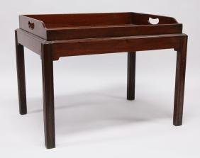 A GEORGIAN STYLE MAHOGANY TRAY TOP BUTLERS TABLE with