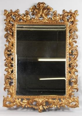 A GOOD 1920'S CARVED AND GILDED ITALIAN MIRROR.