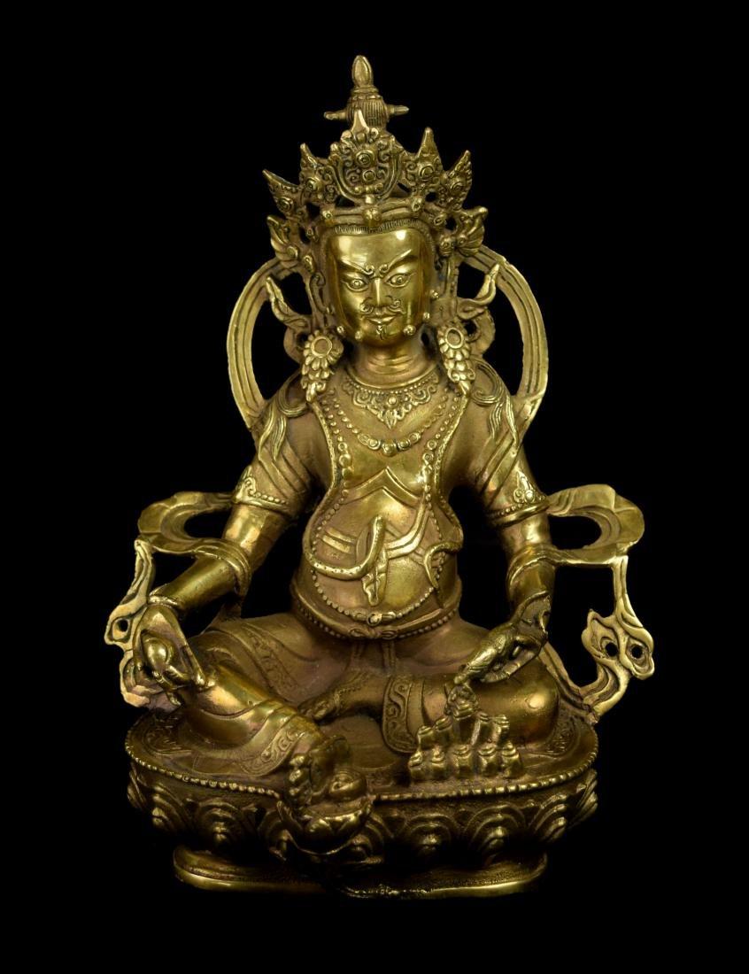 A Tibetan Gilt Bronze Yellow Jambhala (God of Fortune)