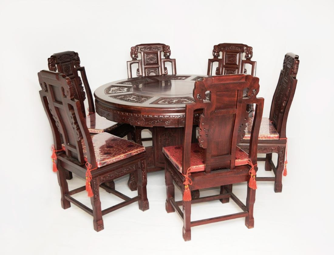 A Red Siamese Rosewood Dining Room Set with Carvings of