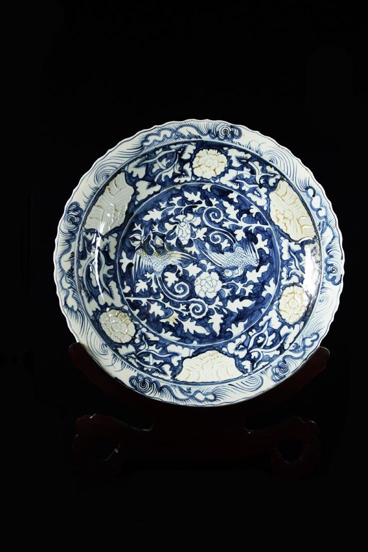 A Large Chinese Reverse Blue and White Porcelain