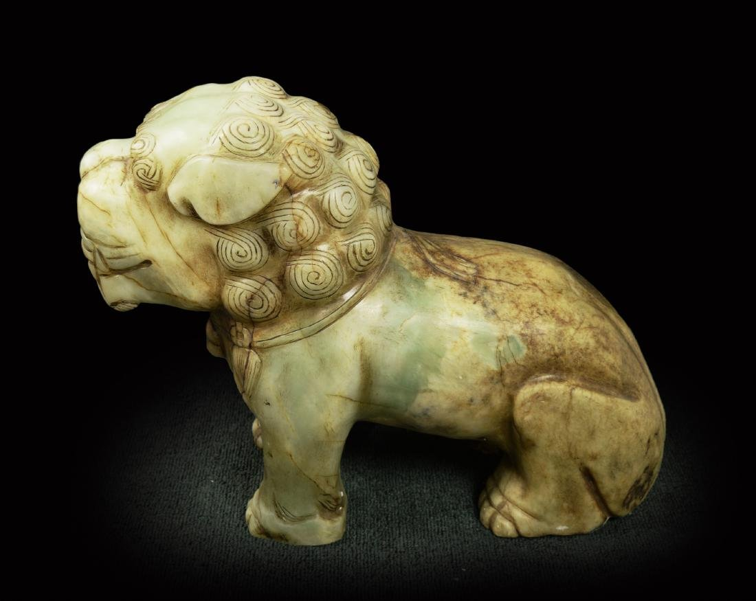 An Old Jade Lion Statue