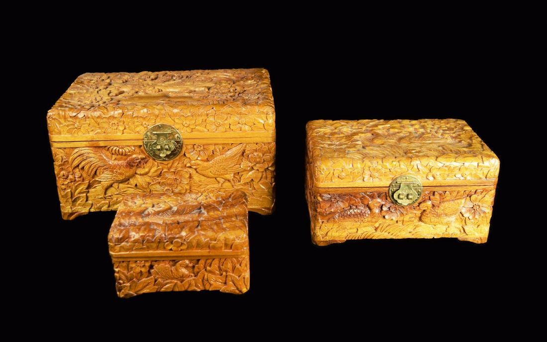 A Set of Three Camphor Wood Jewelry Boxes with Relief