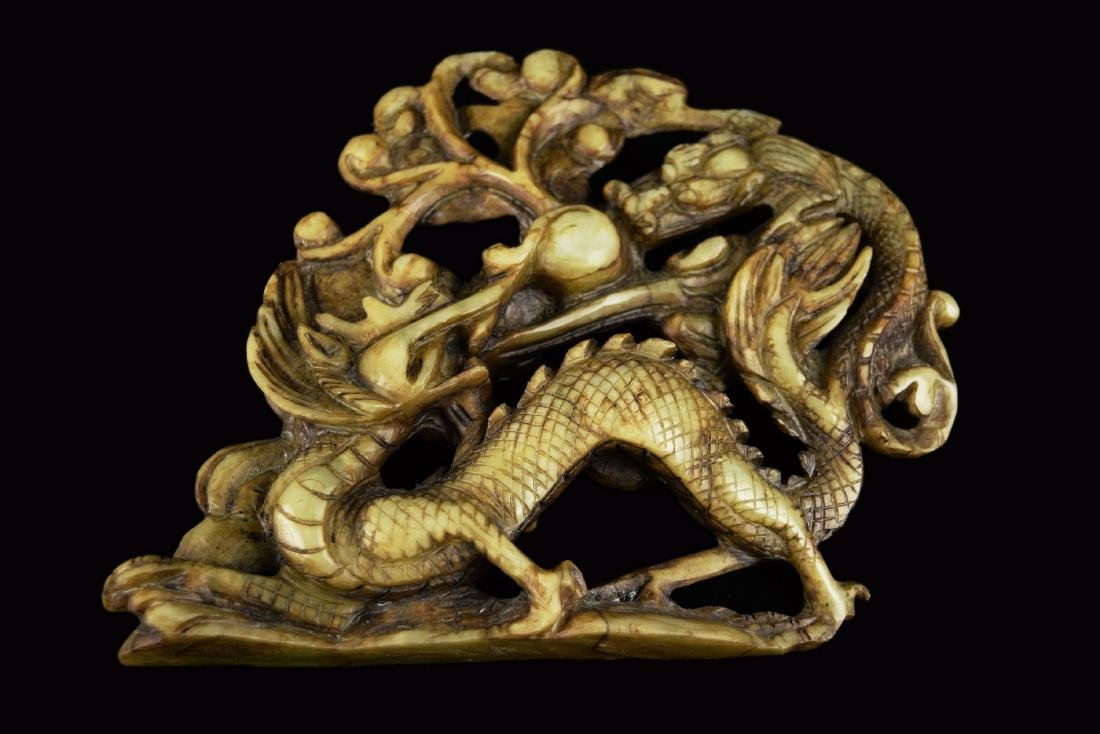 A 19th Century Chinese White Jade Carved Dual Dragons