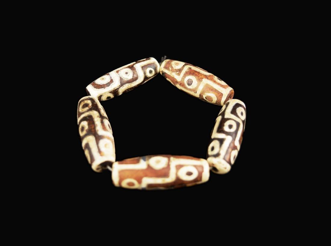 [Chinese] Two Dzi Bead Bracelets and a Dzi Bead - 2