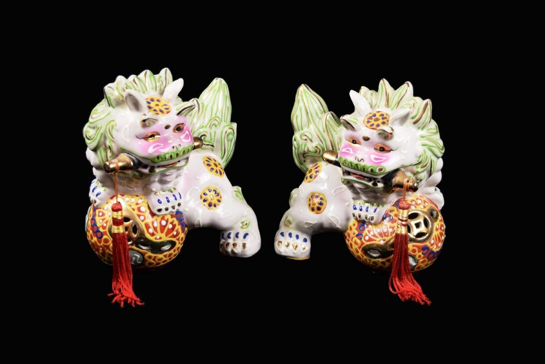 A Pair of Chinese Famille Rose Porcelain Foo Dogs