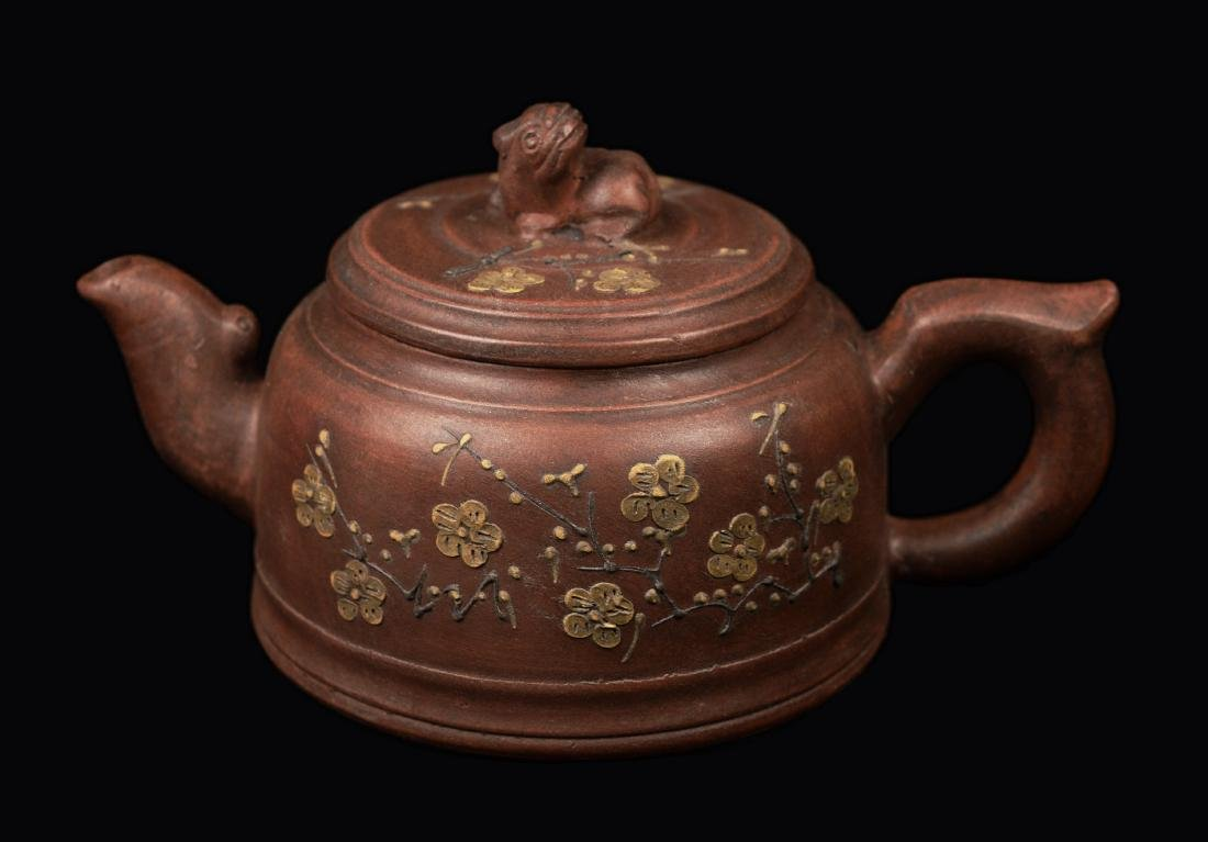 A Chinese Yixing Clay Tea Pot with  Design, marked