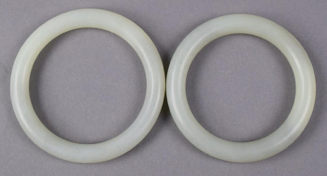 Two Chinese carved white jade bangles - 2