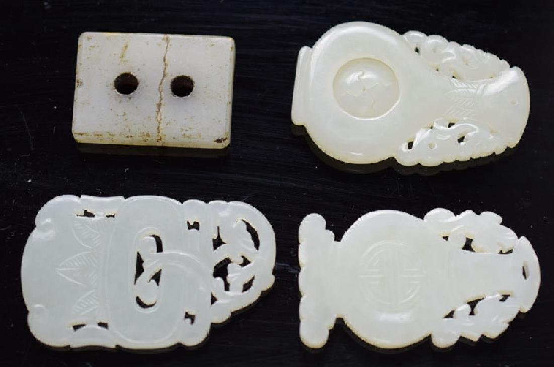 Four pieces Chinese carved white jade openwork pendant