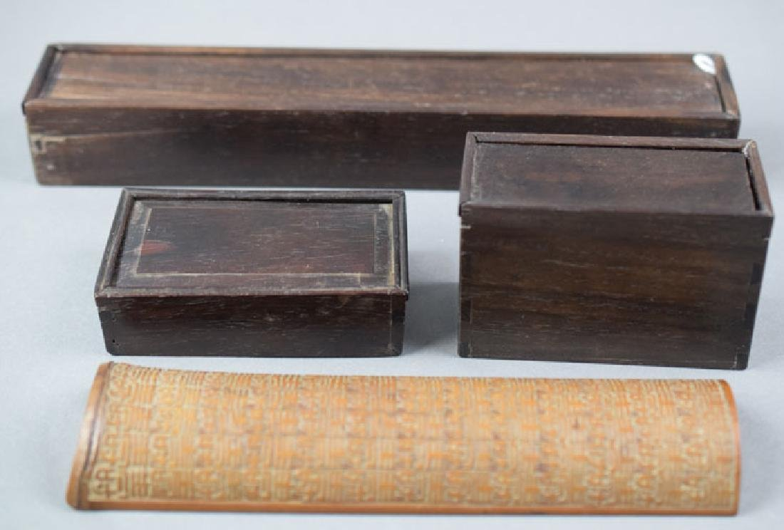 Three Chinese rosewood boxes and a bamboo wrist rest
