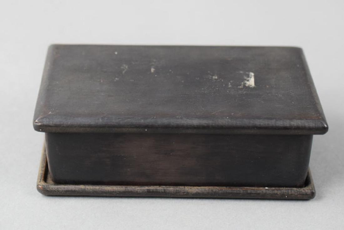 Chinese Qing carved ink stone within a rosewood box
