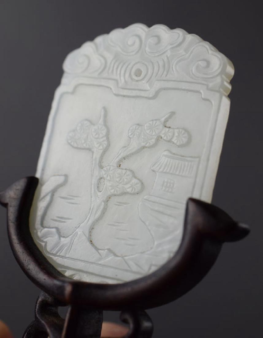 Chinese carved jade pendant raised on a rosewood stand - 2