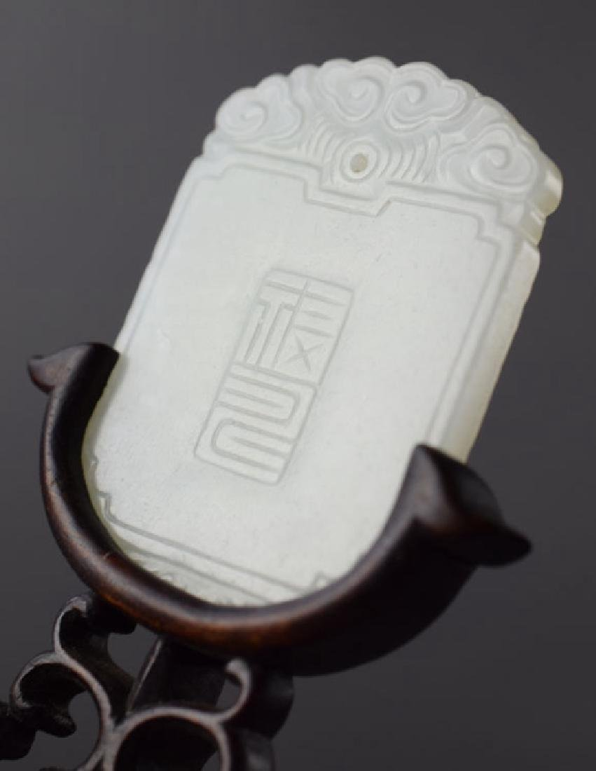 Chinese carved jade pendant raised on a rosewood stand - 4