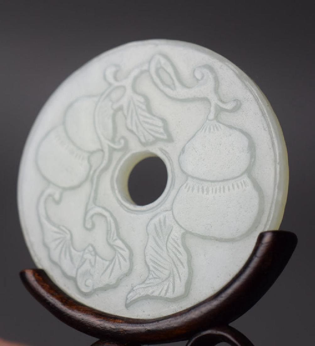 Chinese carved Bi disk raised on a rosewood stand - 3