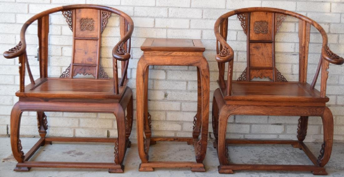 Pr. Chinese carved Huanghuali wood armchairs with a