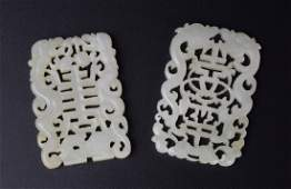 Two Chinese Qing carved jade pendants
