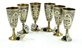 A set of six Russian silver Niello vodka cups