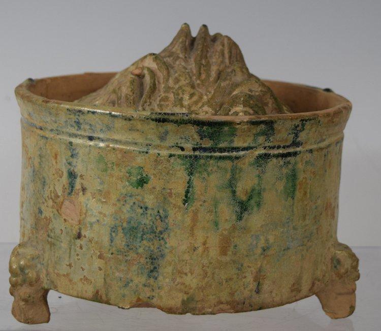 Chinese Zhou-Chin Period An Iridescent Glazed Pottery