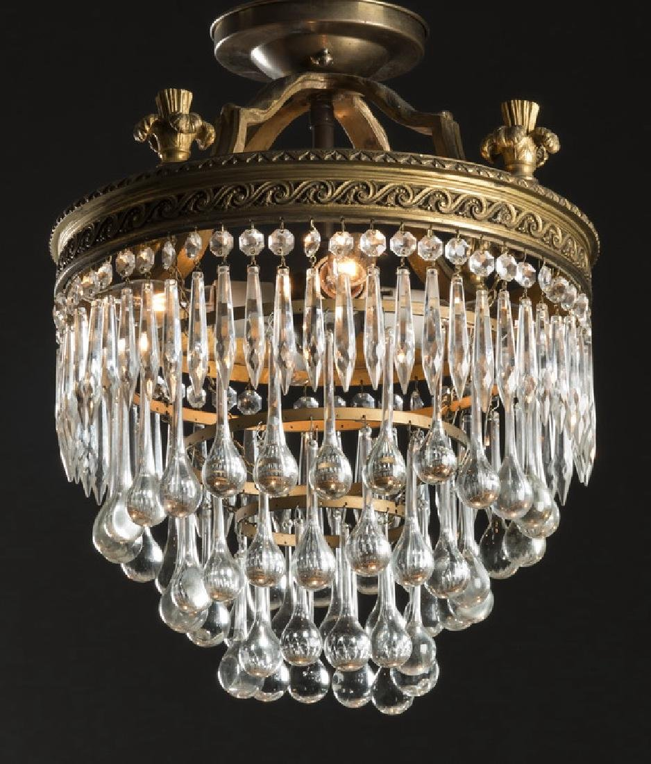 Hollywood Regency style four-tier crystal chandelier