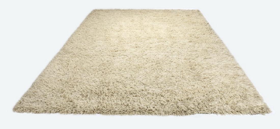 Stark Carpet cream wool shag rug. 17' long