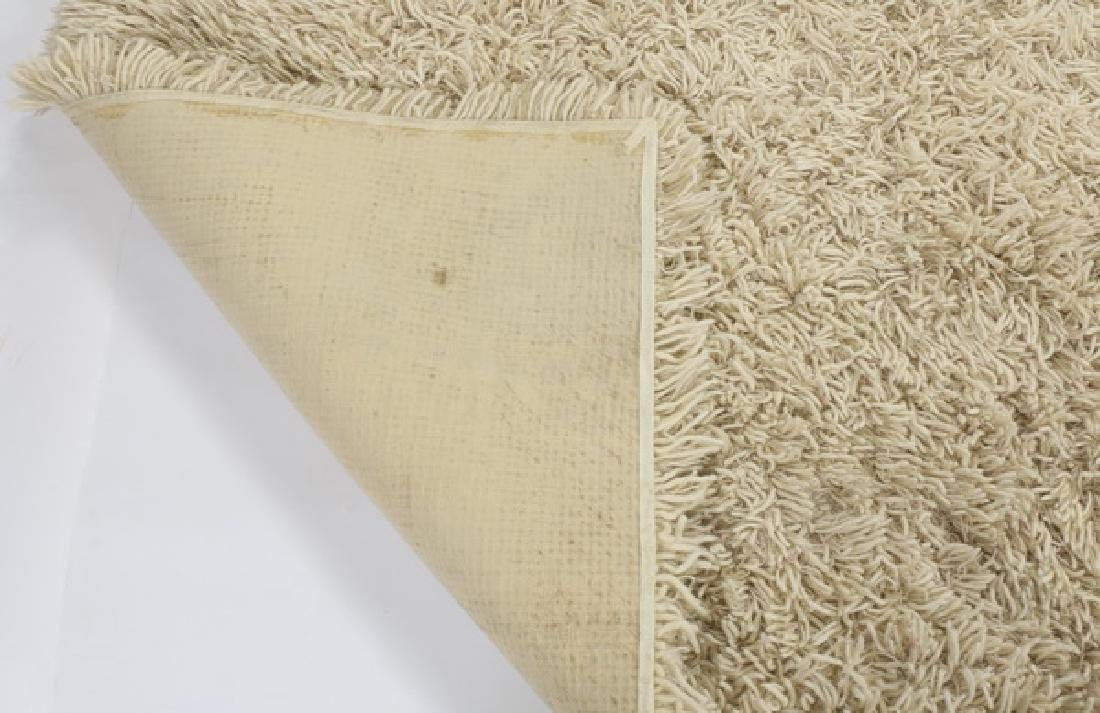 Stark Carpet cream wool shag rug. 17' long - 2