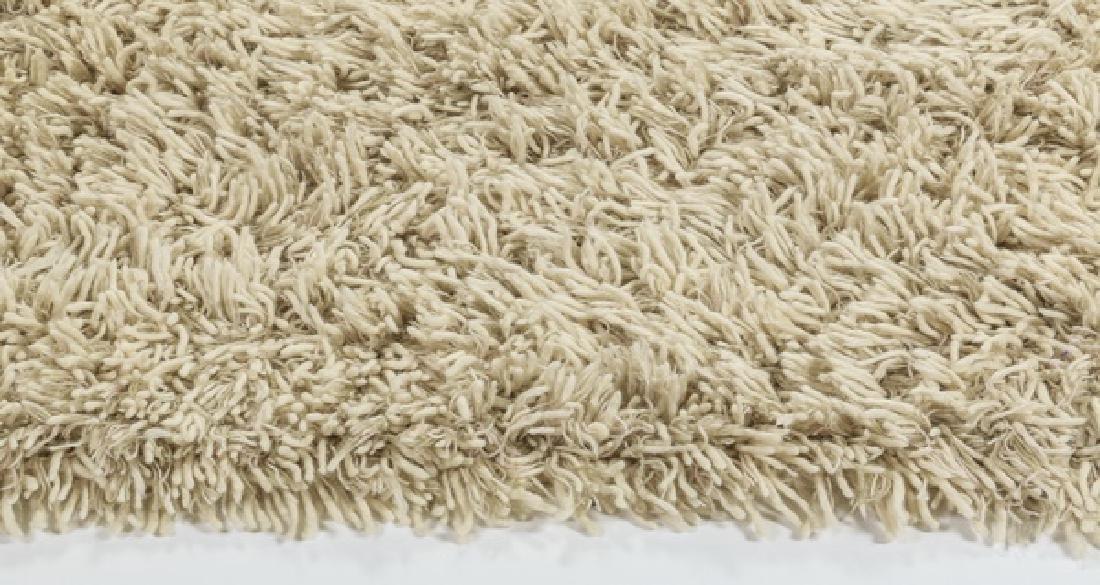Stark Carpet cream wool shag rug. 17' long - 3