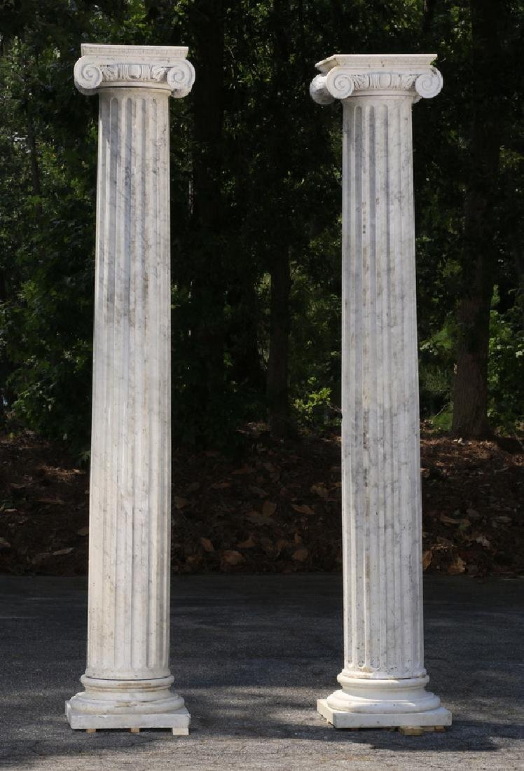 "Pair of classic carved marble Ionic columns, 109""h"