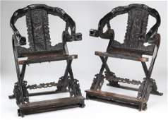 (2) Chinese carved zitan dragon and cloud chairs