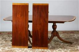 19th c. Sheraton style mahogany table w/ leaves