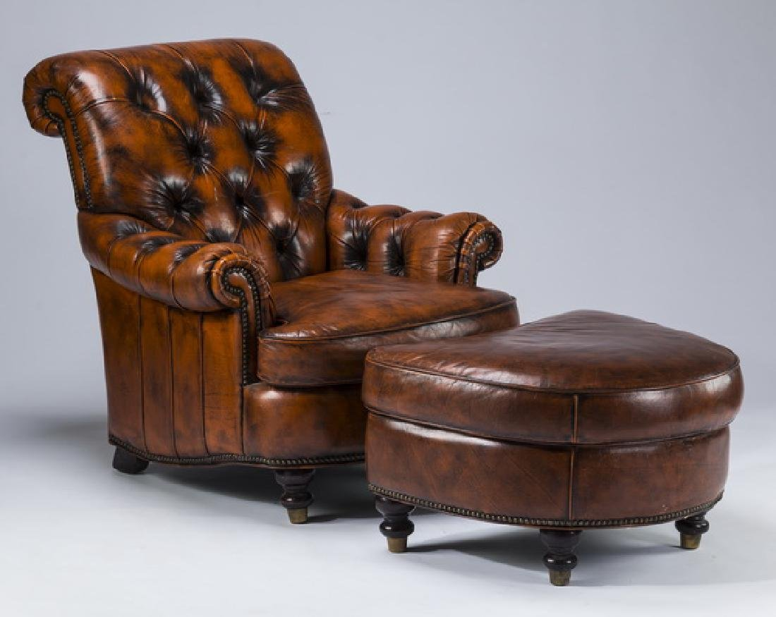 Distressed leather armchair and ottoman