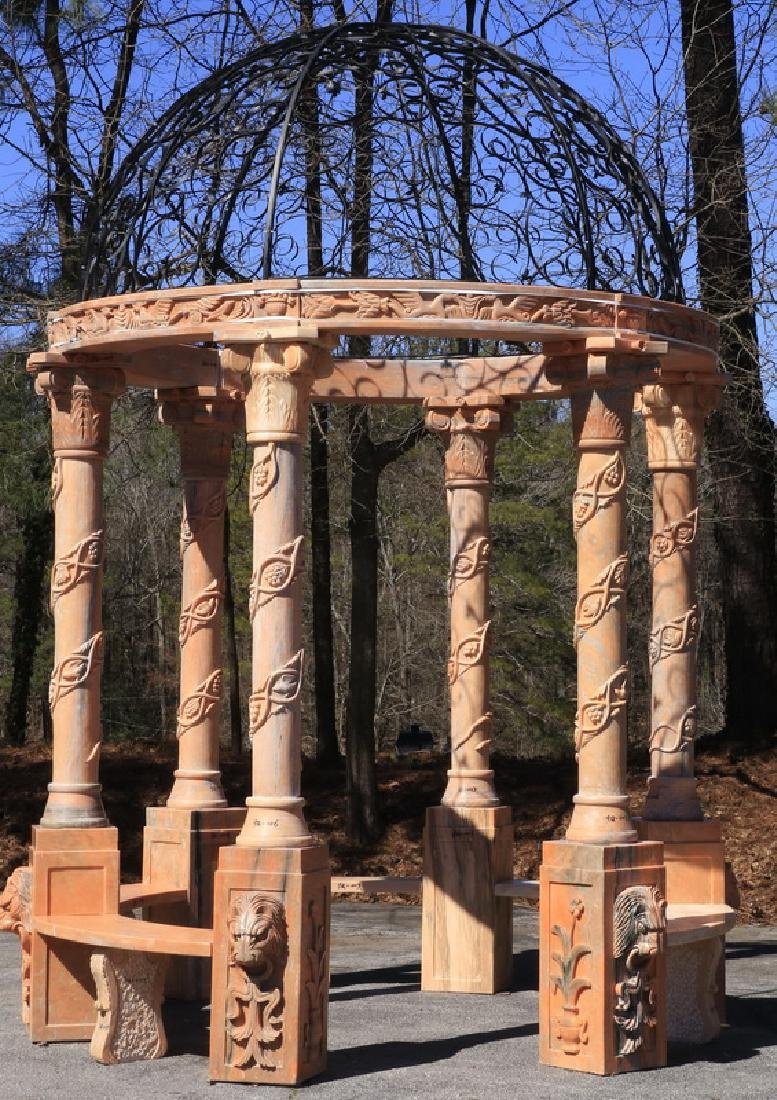 Carved marble gazebo with wrought iron top