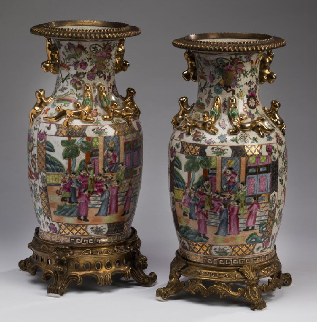 Pair of Chinese  Rose Medallion vases on metal stands