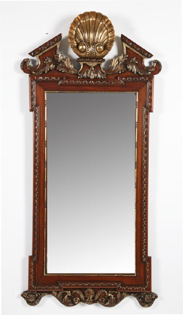 "Carved and parcel gilt mahogany mirror, 63""h"