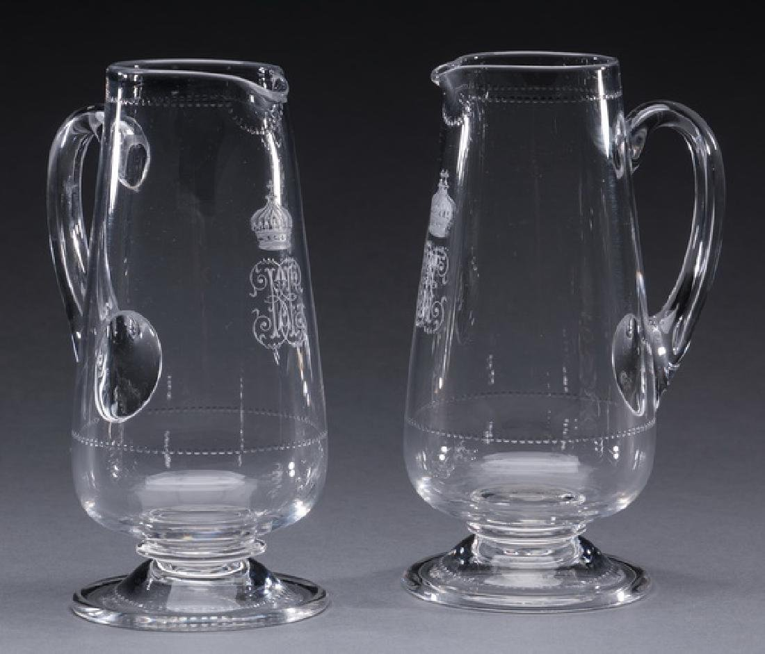 "(2) Continental crystal pitchers, w/ monogram, 7""h"